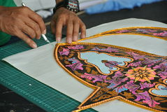 Malaysian kite maker working on a kite in his workshop Royalty Free Stock Images