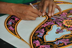 Malaysian kite maker working on a kite in his workshop Royalty Free Stock Photos