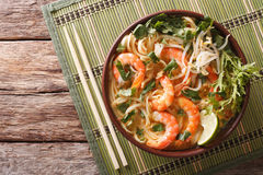 Malaysian laksa soup with shrimps, noodles and herbs close up in Stock Images