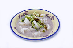 Malaysian Laksam. Malaysian food originated from Kelantan. The long wide noodle is made of rice flour. The gravy is made mainly of coconut milk and other spices royalty free stock photography
