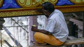 Malaysian Man restoring Batu Caves stock photography