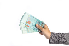 Malaysian money. Female hand holding two hundred ringgit malaysian money isolated on white background royalty free stock photos