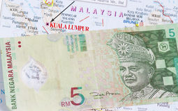 Malaysian money in a map Stock Photo