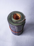 Malaysian money. A shot of rolled up Malaysian currency tied with a rubber band Stock Image
