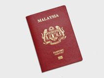 Malaysian Passport. A Malaysian Passport on gray background stock photography