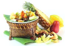 Malaysian Popular Fruit Salad. Malaysian Fruit  Salad topped  with Shrimp Paste on White Back Ground Stock Photo