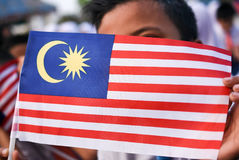 Malaysian primary students with Malaysian Flag during the celebr Stock Photography