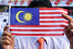 Malaysian primary students with Malaysian Flag during the celebr Stock Photos