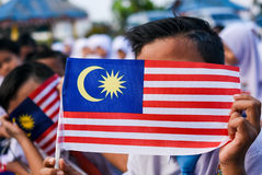 Malaysian primary students with Malaysian Flag during the celebr Stock Images