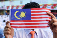 Malaysian primary students with Malaysian Flag during the celebr Royalty Free Stock Photos