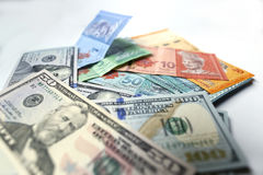Malaysian ringgit and United States Dollar on a white background. With shadow Stock Images