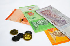 Malaysian Ringgits and Cents. Malaysian ringgit notes and coins isolated on white background Royalty Free Stock Photo