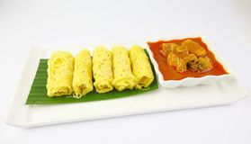 Malaysian Roti Jala on white plate. A popular Malaysian Savoury Snack Roti Jala served with Chicken Curry Royalty Free Stock Photos