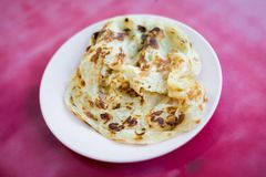 Malaysian roti wheat indian pancake. Fresh prepared malaysian roti wheat indian pancake served in local restaurant in Cameron Highlands. Traditional asian stock photos