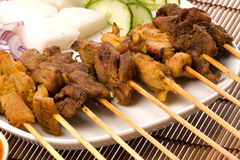 Malaysian Satay. Image of a Malaysian delicacy commonly known as Satay (bamboo stick skewered barbequed meat Royalty Free Stock Photography