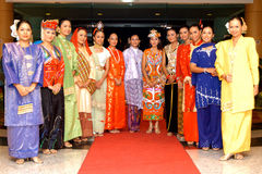 Malaysians. Young malaysian teenagers in variety of traditional costumes Stock Images