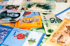 Malaysias Währung GEGEN Chinas Währung Lizenzfreie Stockfotos