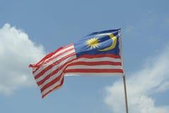 Malaysisk flagga i blåsig luft Royaltyfri Bild