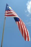 Malaysisk flagga i blåsig luft Fotografering för Bildbyråer