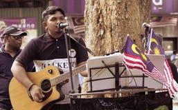 Malaysisk gatasångare Performing Arkivfoto