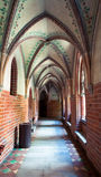 Malbork castle arch corridor. Narrow corridor of the Teutonic castle Malbork in Pomerania region of Poland. UNESCO World Heritage Site. Knights fortress also Stock Image