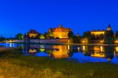 Malbork Castle at dusk in Poland. Malbork Castle of the Teutonic Order at night, Poland Royalty Free Stock Photography