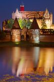 Malbork castle at night. Malbork castle in Poland at night with reflection in Nogat river Stock Images