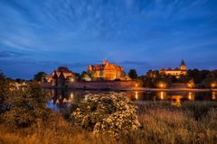 Malbork Castle at Night in Poland. Teutonic Knights medieval fortress, UNESCO World Heritage Site Royalty Free Stock Photos