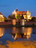 Malbork castle by night with reflection in Nogat. River, Poland Stock Photo