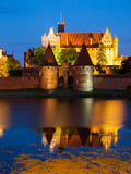 Malbork Castle by night. With reflection in Nogat river, Poland Royalty Free Stock Photos