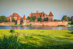 Malbork Castle at Nogat River in Poland, Europe Royalty Free Stock Photos