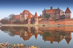 Malbork Castle and reflection in River Nogat, Poland. royalty free stock images