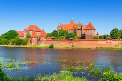 Malbork castle in summer scenery Stock Photos