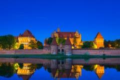 Malbork Castle at dusk in Poland. Malbork Castle of the Teutonic Order at night, Poland Stock Photo
