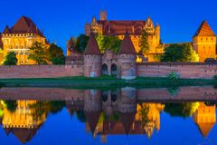 Malbork Castle at dusk in Poland. Malbork Castle of the Teutonic Order at night, Poland Stock Images