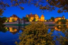 Malbork Castle at dusk in Poland. Malbork Castle of the Teutonic Order at night, Poland Royalty Free Stock Photo