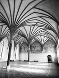 Malbork Grand Refectory. The Grand Refectory, the biggest hall in Malbork Castle with beautiful gothic rib vault ceiling, Poland. Black and white image Royalty Free Stock Photo