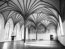 Malbork Grand Refectory. The Grand Refectory, the biggest hall in Malbork Castle with beautiful gothic rib vault ceiling, Poland. Black and white image Stock Photography