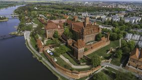 Malbork a powerful Teutonic castle over the Nogat from a bird`s eye view stock photography