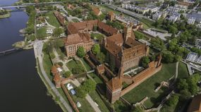 Malbork a powerful Teutonic castle over the Nogat from a bird`s eye view stock photo