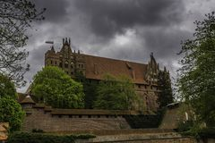 Malbork a powerful Teutonic castle over the Nogat royalty free stock photo