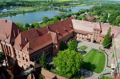 Malbork, Pologne : Château et fleuve Nogat de Malbork Image libre de droits