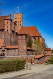 Malbork, pomorskie / Poland - April, 16, 2019 :: Historic Teutonic castle in Central Europe. A brick building from the Middle Ages. Season of the spring stock photography