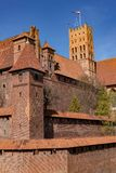 Malbork, pomorskie / Poland - April, 16, 2019 :: Historic Teutonic castle in Central Europe. A brick building from the Middle Ages. Season of the spring stock photo