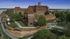 Malbork a powerful Teutonic castle over the Nogat from a bird`s eye view royalty free stock photo