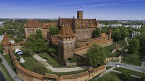 Malbork a powerful Teutonic castle over the Nogat from a bird`s eye view stock image