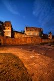 Malbork Schloss nachts Lizenzfreie Stockbilder
