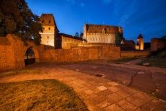 Malbork Schloss nachts Stockfotografie