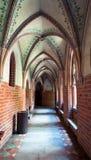 Malbork-Schlossbogenkorridor Stockbild