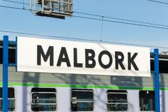 Malbork sign on train station. Stock Images